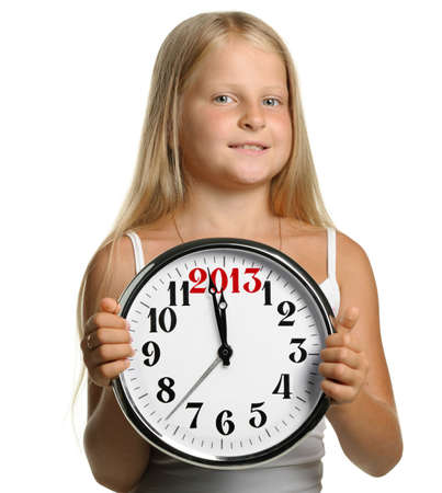 The girl hold in hands a big clock with figures 2013. It is isolated on a white background photo