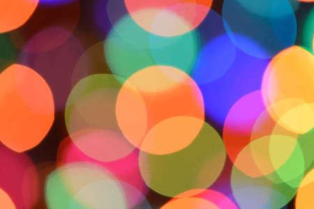 blurring: Defocused color background. Blurring the image colourful festive lights
