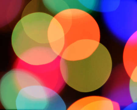 Defocused color background. Blurring the image colourful festive lights Stock Photo - 14990324