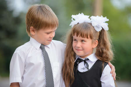 Preschool children a boy and a girl. Photography outdoors photo