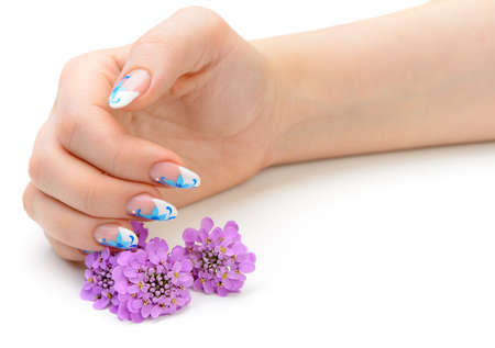 Nail art. Female nails with figure of petal blue color closeup and flower Stock Photo - 14972540