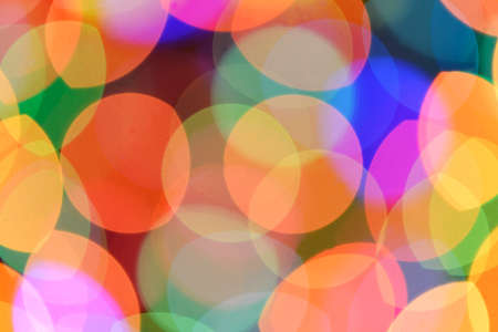 lighting background: Defocused color background. Blurring the image colourful festive lights