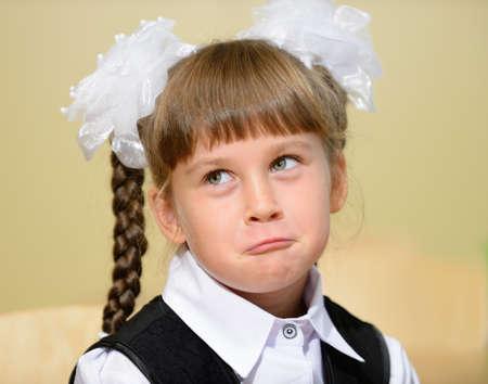 elementary age girl: humorous photo schoolgirl.His hurt expression