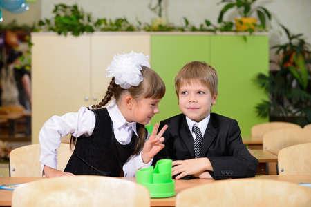 The conversation schoolchild. Sitting at a Desk photo