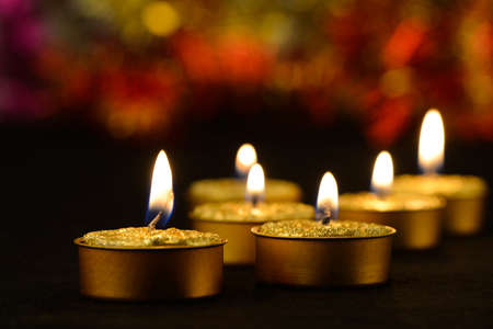 Golden burning candles bokeh blured background photo