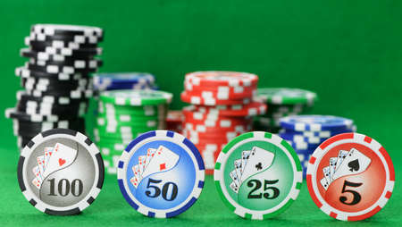 poker chip: Gaming chips on the green cloth. High detailed photo