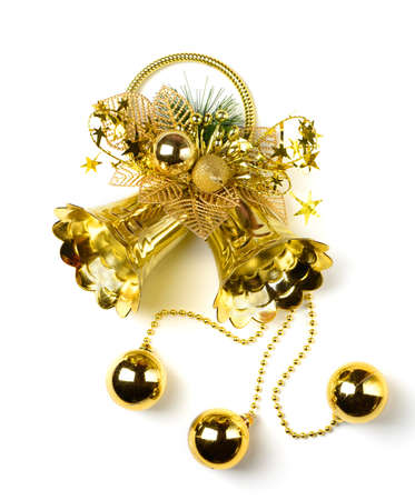 Golden bell with a holiday ornament. Isolated on white background photo