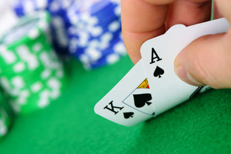 Gaming cards  in hand on the green cloth. A winning combination in Black Jack Stock Photo