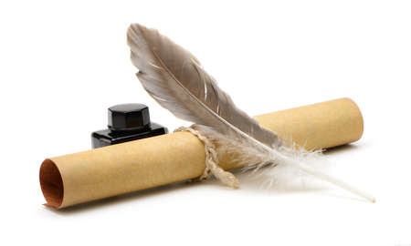 A feather pen, ink,rolls of old yellowed paper. Isolated on a white background.