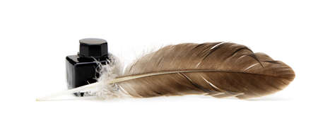A feather pen, ink. Isolated on a white background.