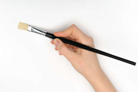 Hand with a brush. Over a grey empty paper, drawing imitation Stock Photo - 16060917