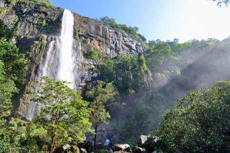 The waterfall with sunlight. The waterfall with the mountains in the country of Sri Lanka Stock Photo - 16596804