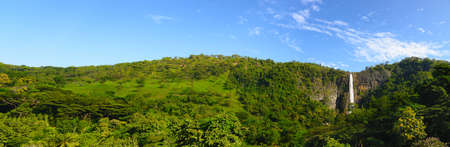 The waterfall panoramic photo. The waterfall with the mountains in the country of Sri Lanka photo