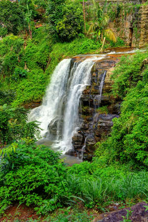 The waterfall. The waterfall with the mountains in the country of Sri Lanka photo