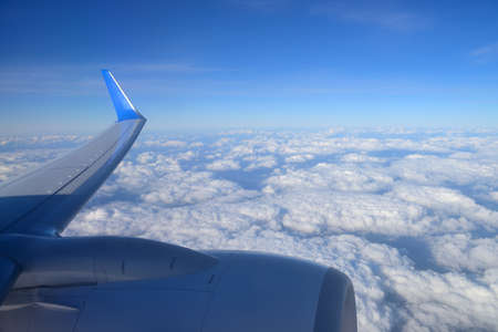 above the clouds: The wing aircraft over clouds