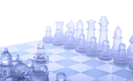 Glass chess. The first move. Blue toned. Stock Photo