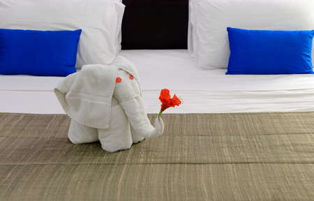 room in a hotel with an elephant from the towel on the bed . The tropical island of Sri Lanka