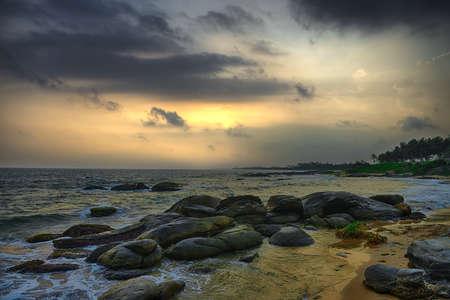 Coast of the Indian ocean. Sunset, stone. Sri Lanka Stock Photo