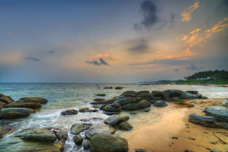 Coast of the Indian ocean. Sunset, stone. Sri Lanka photo