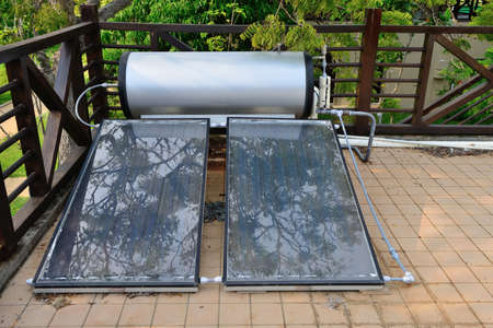 solar power panel. On the roof of the building, for water boiler heating Stock Photo
