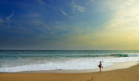 woman on the wide beach of the ocean. Beautiful shores of the Indian ocean Stock Photo