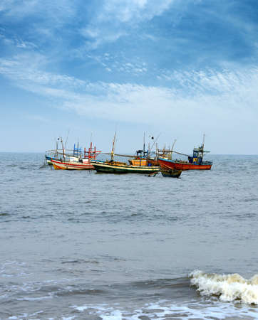 Fishing boats in the ocean . The brightly colored boats moored to the shore of the Indian ocean Stock Photo - 17719084