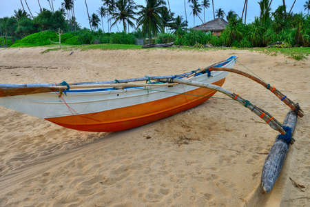 Fishing boats on a tropical beach . The brightly colored boats for fishing Stock Photo