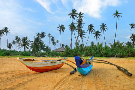 Fishing boats on a tropical beach . The brightly colored boats for fishing photo