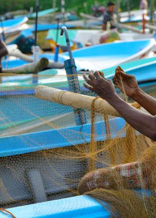 Fisherman sets of fishing gear. Fragment photo