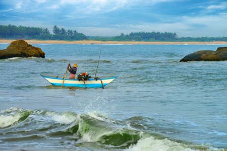 Fisherman sailing on a boat. Indian ocean. Island Sri Lanka