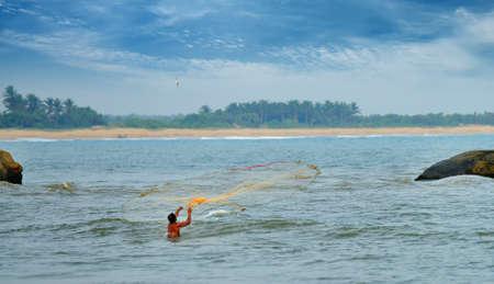 fisherman catches a fishing nets.Indian ocean. Island Sri Lanka