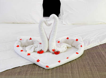 newlyweds: room in a hotel with swans from the towel on the bed . The tropical island of Sri Lanka Stock Photo