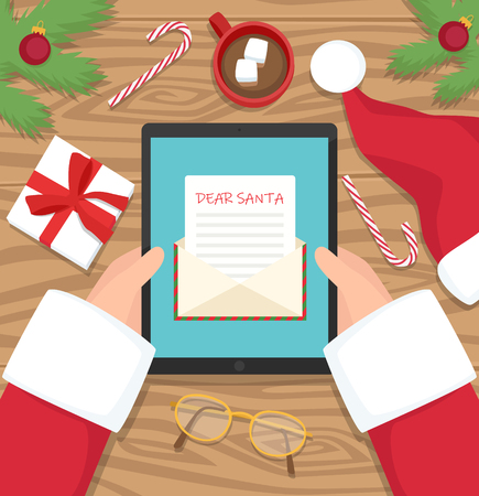 Santa claus is sitting at his workplace on a tablet - vector flat design illustration