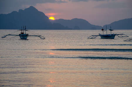 nido: bancas boats on sunset in el nido palawan philippines Stock Photo