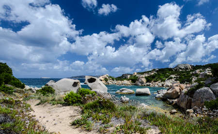 granit: cloudy landscape and granit rocks on beach in sardinia italy