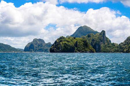 palawan: Rough sea by Cadlao island. El-nido on Background, Palawan, Philippines. Stock Photo