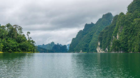 kao sok: Cheo Lan Lake in Khao Sok, Suratani, Thailand. Rainy Clouds. Low Season Stock Photo