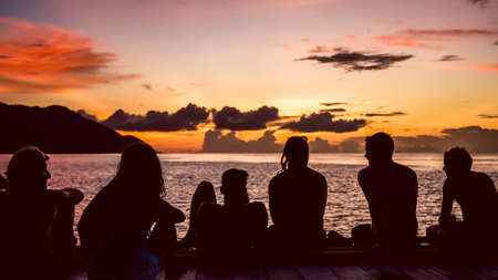 pristine corals: Travelers, Divers chilling at the Pier on Sunset, Kri Island. Raja Ampat, Indonesia, West Papua.
