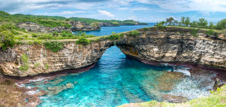 Rock coastline of Nusa Penida. Stone arch over the sea. Broken beach, Nusa Penida,Indonesia