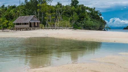 Empty Water Hut on Sand Bank between Kri Island and Monsuar. Raja Ampat, Indonesia, West Papua. Stock Photo