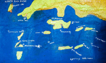 Hand painted Map of Raja Ampat Diving Spots on an Board, Indonesia. West Papua