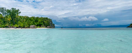 pristine corals: Water Hut of Homestay on Kri Island. Raja Ampat, Indonesia, West Papua. Wide Stock Photo