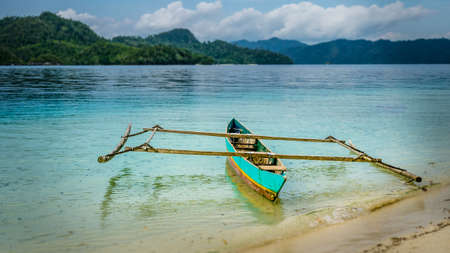 primeval: Colourful Local Boat on Friwen Island, West Papuan, Raja Ampat, Indonesia Stock Photo