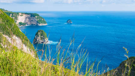 oceanic: Coastline, Thousand Island, near Manta Bay or Kelingking Beach on Nusa Penida Island, Bali, Indonesia