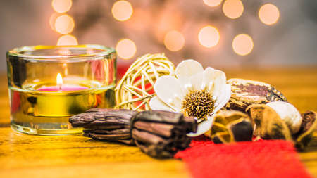 Candle and Potpourri on burlap with light bokeh in background Stock Photo