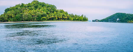 Friwen Island in Front and Friwen Wall in Background, West Papuan, Raja Ampat, Indonesia Stock Photo