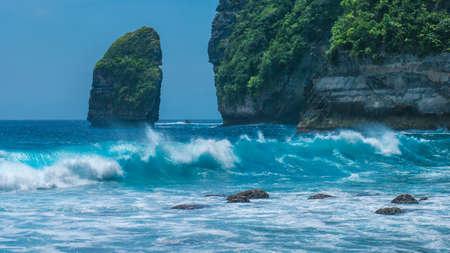 nusa: Rock in Tembeling Coastline at Nusa Penida island, Ocean Waves in Front. Bali Indonesia