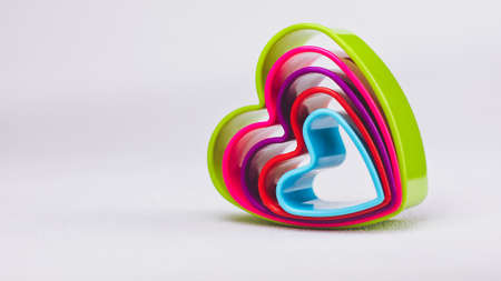white backing: Heart shaped cookie cutter on white background Stock Photo