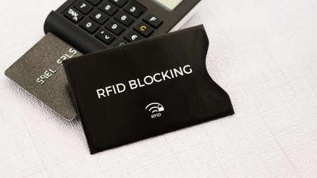 lock block: RFID protection sleeve for secure credit card from wireless stealing money, TAN generator with card on middle ground