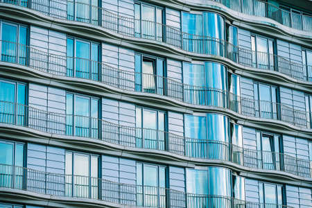 Modern glass building with railing of an hotel